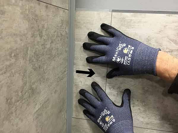 Pull tile into inter-locking joints