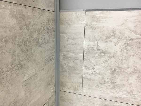 Inter-locking joints at tile's right and bottom are tight