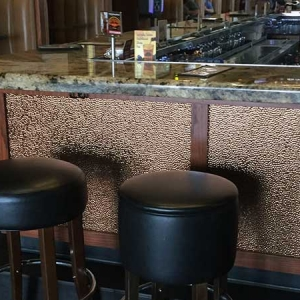 Milwaukee Burger - Fasade Hammered Wall Panel in Oil-Rubbed Bronze