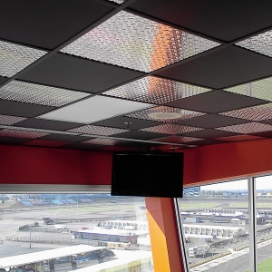Charlotte Motor Speedway - Genesis Smooth-Pro Ceiling Panels in Black and Fasade's Diamond Plate in Brushed Aluminum