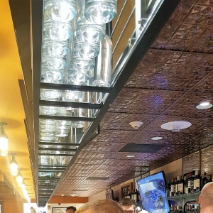 Stone Arch Restaurant - Fasade Traditional 1 Ceiling Tile in Moonstone Copper